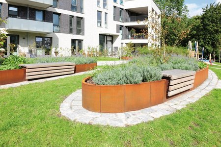 Thanks to their integrated, wooden seating areas, the 450mm-high planting systems invite passers-by to sit and take in the courtyard.